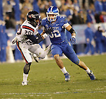 Kentucky Wildcats linebacker Miles Simpson (32) runs against Samford Bulldogs safety Jay West (20) during the second half of the UK Football game v. Samford at Commonwealth Stadium in Lexington, Ky., on Saturday, November 17, 2012. Photo by Genevieve Adams | Staff
