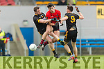Jack Brosnan Glenbeigh in action against Austin O'Malley and Padraig O'Malley Louisburgh in the AIB GAA Football Junior All Ireland Club Championship Semi Final in Ennis on Sunday.