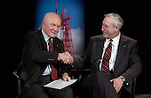 Former United States Senator John H. Glenn, Jr., left, shakes hands with NASA Administrator Sean O''Keefe February 20, 2002 at NASA headquarters in Washington, DC. Glenn stopped by NASA to commemorate the 40th anniversary of his historic Project Mercury orbital flight. On February 20, 1962, Glenn became the first American to orbit the Earth, hurtling around the globe three times in a flight that lasted nearly five hours..Mandatory Credit: Bill Ingalls / NASA via CNP