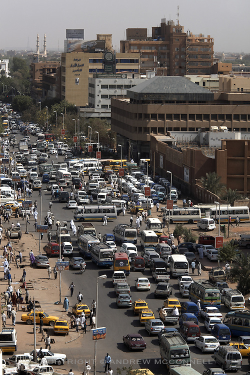 Congestion is a part of everyday life in Khartoum, here early morning traffic blocks Sharia Pasha al Mek, a main thoroughfare in Souq Al-Arabi, central Khartoum, Sudan, on Thursday, Apr. 12, 2007..Khartoum is modeling itself as the Dubai of Africa and despite Western sanctions the city is booming. Away from the troubles and poverty that plaque the rest of Sudan, development in Khartoum is moving at an astonishing rate. Investment from the East, and in particular China, allowed the Sudanese economy to grow by 11% in 2007. This growth is driven largely by oil, with production rising from 63,000 barrels per day in 1999 to over 500,000 barrels today.