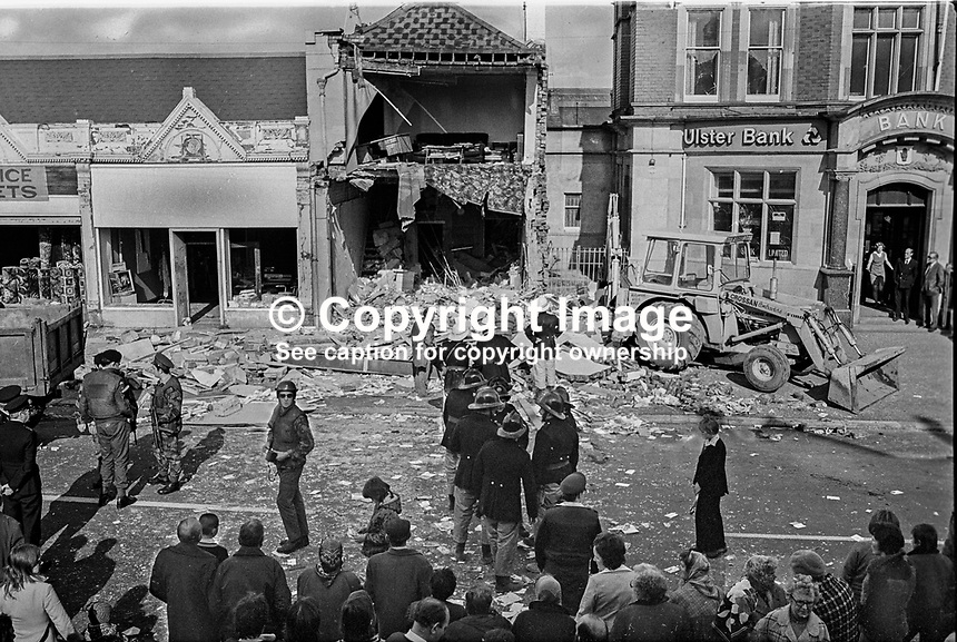 Scene of 3 Oct 1975 explosion at business premises on the Albertbridge Road, Belfast, N Ireland, UK, owned by John McKeague, a prominent loyalist activist. A 57 year old Roman Catholic mother of eight, Mrs Alice McGuinness, died in the blast. Ironically Mrs McGuinness, of Bryson Street, in the nearby staunchly republican Short Strand area was a shopper at Mr McKeague's printing and stationery business. Mr McKeague's sister, Mrs Jean Moore, was injured in the explosion. Mr McKeague's mother, Isabella McKeague, died in a fire that followed an attack four years earlier on the same premises. 197510030002.<br />
