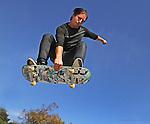 Chase gets some air while skateboarding at San Francisco Portreo del Sol/La Raza Skatepark.