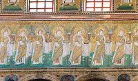 Byzantine Roman mosaics , c. 561 AD, in the Basilica of Sant'Apollinare Nuovo, depicting 22 Virgins led by the Three Magi, moving from the city of Classe towards the group of the Madonna and Child surrounded by four angels. Ravenna Italy, A UNESCO World Heritage Site.