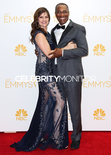 LOS ANGELES, CA, USA - AUGUST 25: Actor Joe Morton and Christine Lietz pose in the press room at the 66th Annual Primetime Emmy Awards held at Nokia Theatre L.A. Live on August 25, 2014 in Los Angeles, California, United States. (Photo by Celebrity Monitor)
