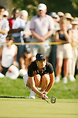 Apr. 1, 2006; Rancho Mirage, CA, USA; Michelle Wie lines up her putt during the 3rd round of the Kraft Nabisco Championship at Mission Hills Country Club. ..Mandatory Photo Credit: Darrell Miho.Copyright © 2006 Darrell Miho .