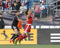 Foxborough, Massachusetts - May 23, 2015: First half action. In a Major League Soccer (MLS) match, the New England Revolution (red) vs D.C. United (black), 1-0 (halftime), at Gillette Stadium.