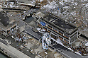 February 26, 2012, Fukushima, Japan - A tsunami-damaged and abandoned fishing boat, center front, is seen in Namie, Fukushima Prefecture, in this aerial photo taken from a Mainichi helicopter on Feb. 26, 2012.