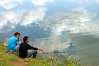 Turkish fishermen fishing in lake in Turkey