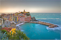 This Vernazza image was taken at sunrise. The Cinque Terre is a beautiful location along the Ligurian Coast of Italy. Take a train from Genoa or Pisa and stay in a quaint room by the rocky beach and cozy harbor and you will not want to leave!