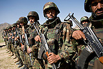 Afghan National Army soldiers line up for a shura, or community meeting in Chenar, Kandahar province, Afghanistan that involved local Afghans, US military, Afghan governing officials, and NATO leaders on Thursday, March 22, 2007.