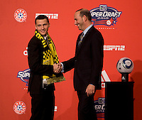 MLS commissioner Don Garber welcomes Dilly Duka of Rutgers  to the stage as the eighth overall pick of  the MLS Superdraft by the Columbus Crew at the Pennsylvania Convention Center in Philadelphia, PA.