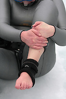 Elisabeth Kristoffersen having cold feet and hands after diving. Freediving competition Oslo Ice Challenge at freshwater lake Lutvann outside the Norwegian capital Oslo.