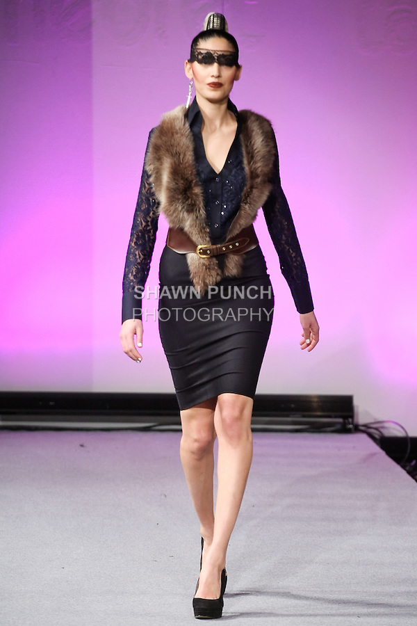Model walks the runway in an outfit from the Edwing D'Angelo Fall 2012 Beauty Attack collection, during Couture Fashion Week New York, February 19, 2012.