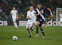 The USA's Oguchi Onyweu defends the ball against England's Wayne Rooney in the second half of the 2010 World Cup match between USA and England in Rustenberg, South Africa on Saturday, June 12, 2010.