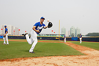 17 August 2007: Pierrick Le Mestre practices during the Good Luck Beijing International baseball tournament (olympic test event) at the Wukesong Baseball Field in Beijing, China.