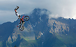 A member of the Xtreme Motorcross Team flies across the vista of Pioneer Peak during a performance at the Alaska State Fair.