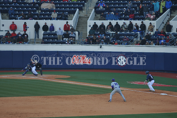 Ole Miss' Auston Bousfield (9) drives in Tanner Mathis (12) vs. TCU at Oxford-University Stadium on Saturday, February 16, 2013. Ole Miss won 5-2. Huber picked up his second save of the season.