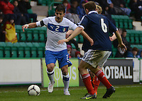 Italy U21 Giulio Donati controls the ball infront of Scotland U21 Liam Kelly