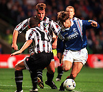Brian Laudrup goes past John Clark and a posse of Pars denenders