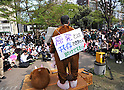 April 16, 2011, Tokyo, Japan - Some 1,500 anti-nuclear power plant demonstrators, including farmers, march through the streets of Tokyo's Shibuya district on Saturday, April 15, 2011, calling on Japanese Prime Minister Naoto Kan for taking responsibility for the accident at a nuclear power plant in Fukushima, northeast of Tokyo. Wearing variety of costumes and carrying placards, participants called on Kanto to step down for his poor handling of the nuclear accident and the aftermath of March 11 earthquake and tsunami. (Photo by Natsuki Sakai/AFLO) [3615] -mis-