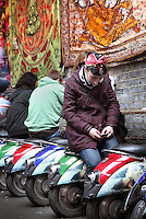 Row of half-scooters uses as seats, main entrance to Candem Town markets, open-air and indoor markets, London, UK. Picture by Manuel Cohen