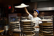 Tossing dough at Lilly's Pizza, in Durham, Thursday, July 12, 2012.