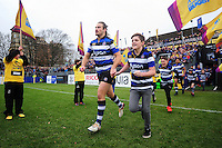 Max Clark of Bath Rugby, mascot in hand, runs out onto the field. Aviva Premiership match, between Bath Rugby and Saracens on December 3, 2016 at the Recreation Ground in Bath, England. Photo by: Patrick Khachfe / Onside Images