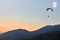 Paraglider flying in tandem, at sunset (Licence this image exclusively with Getty: http://www.gettyimages.com/detail/95794854 )