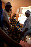 9 December 2009, Banikoara, Benin. Community Health Clinic &quot;Comparou Maternit&eacute;.&quot; The clinic delivers a wide variety of services including delivering of babies and ante-natal checkups. The mothers-to-be are given an ante-natal package of folic acid, mosquito nets and malaria prophylactics. If there is an emergency, an ambulance can take them to the main hospital. 30 year-old housewife Nowiatau Alidau is about 8 months pregnant with her third child.