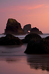 Sunset at Ecola State Park in Oregon with haystacks along the beach