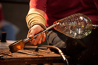 Master glass artist,making a glass pitcher, at the Wheaton Arts and Cultural Center, Millville, New Jersey