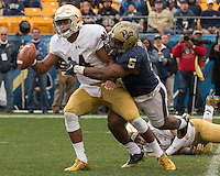 Pitt defensive end Ejuan Price (5) sacks Notre Dame quarterback DeShone Kizer. The Notre Dame Fighting Irish football team defeated the Pitt Panthers 42-30 on Saturday, November 7, 2015 at Heinz Field, Pittsburgh, Pennsylvania.