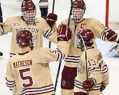 Bill Arnold (BC - 24), Michael Matheson (BC - 5), Patrick Brown (BC - 23) and Johnny Gaudreau (BC - 13) celebrate. - The Boston College Eagles defeated the visiting University of Notre Dame Fighting Irish 4-2 to tie their Hockey East quarterfinal matchup at one game each on Saturday, March 15, 2014, at Kelley Rink in Conte Forum in Chestnut Hill, Massachusetts.