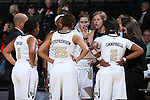 25 February 2016: Wake Forest head coach Jen Hoover talks to her team during a timeout. The Wake Forest University Demon Deacons hosted the Virginia Tech Hokies at Lawrence Joel Veterans Memorial Coliseum in Winston-Salem, North Carolina in a 2015-16 NCAA Division I Women's Basketball game. Virginia Tech won the game 54-48.