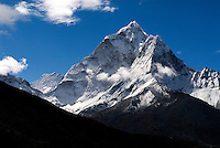 "For several days, along the trail to Everest base camp the towering peak of Ama Dablam dominates the mountain skyline. Ama Dablam means ""Mother's necklace? and is named for the outstretched arms of a mother (ama), seen as the Southwest and Northwest ridges and the hanging ice pendant positioned below the head wall; and the hanging glacier thought of as the dablam ( a traditional double-pendant containing pictures of the gods, worn by Sherpa women)."