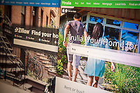 The real estate websites of Zillow and Trulia are seen on a computer screen side-by-side on Friday, July 25, 2014. Zillow, which is the largest U.S. real estate website, is reported to be interested in purchasing its competitor Trulia in a deal worth an estimated $2 billion. Both companies connect buyers (and renters) with brokers, selling advertising and charging for preferred placement. The two companies account for an estimated 89 percent of real estate traffic. (© Richard B. Levine)