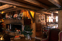 In this traditional French mountain chalet a large fireplace in the centre of the house separates the dining area from the living room