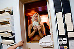 Sex worker Kandi shows of her cash at the booking window of the Moonlite Bunny Ranch brothel in Mound House, NV on Friday, July 28, 2006...The Moonlite Bunny Ranch brothel in Mound House, Nevada - just a few miles from the state capital in Carson City - first opened in 1955. The Ranch is a legal, licensed brothel owned by Dennis Hof. It's featured in the HBO series &quot;Cathouse.&quot;