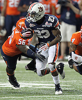 ATLANTA, GA - DECEMBER 31: Onterio McCalebb #23 of the Auburn Tigers runs past defenders during the 2011 Chick Fil-A Bowl against the Auburn Tigers at the Georgia Dome on December 31, 2011 in Atlanta, Georgia. Auburn defeated Virginia 43-24. (Photo by Andrew Shurtleff/Getty Images) *** Local Caption *** Onterio McCalebb