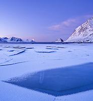 Ice on Haukland beach in winter, Vestvagøy, Lofoten islands, Norway