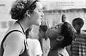 Rio de Janeiro, Brazil. Street children attending workshop at São Martinho Institution, a non-profit Organization dedicated to take children out of the streets in Rio de Janeiro...Foreigner..social worker plays with a street boy...