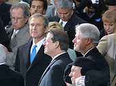 """United States President-elect George W. Bush gives Vice President Al Gore a """"gotcha"""" look as United States President Bill Clinton enjoys the last minutes of his presidency at the U.S. Capitol in Washington, D.C. on January 20, 2001.  Bush defeated Gore in a hard fought election where Gore won the popular vote but lost to Bush who captured the Electoral College by winning in Florida. .Credit: Arnie Sachs / CNP"""
