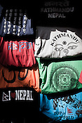 Local Nepalese T-shirts are put on display at a street vendor's stall in Thamel in capital Kathmandu, Nepal