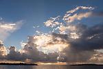 Kauehi Atoll, Tuamotu Archipelago, French Polynesia; sunset rain clouds over Arikitamiro Pass