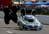 Sep 28, 2013; Madison, IL, USA; NHRA funny car driver Alexis DeJoria during qualifying for the Midwest Nationals at Gateway Motorsports Park. Mandatory Credit: Mark J. Rebilas-