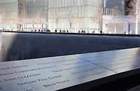 Names of victims of the 9/11 terrorist attacks inscribed around the North Tower pool of the National September 11 Memorial & Museum, designed by Davis Brody Bond, Michael Arad and Peter Walker, on the site of the original Twin Towers World Trade Center buildings which were destroyed in the terrorist attack of 11th September 2001, Manhattan, New York, New York, USA. The memorial and museum commemorate the 9/11 attacks, which killed 2,977, and the World Trade Center bombing of 1993, which killed 6. The memorial forms part of the new World Trade Center complex, which includes 5 skyscrapers and the museum. The memorial consists of 2 enormous reflecting pools and waterfalls within the footprint of the Twin Towers, surrounded by trees. Picture by Manuel Cohen