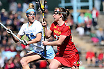 27 February 2016: Maryland's Megan Whittle (right) and North Carolina's Stephanie Lobb (34). The University of North Carolina Tar Heels hosted the University of Maryland Terrapins in a 2016 NCAA Division I Women's Lacrosse match. Maryland won the game 8-7.