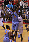 Andrew Wiggins jumps to grab a rebound at Scott County High School in Lexington, Ky., on Sunday, November 18, 2012. Photo by Tessa Lighty | Staff