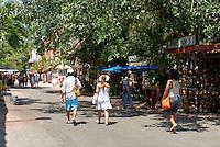 Tourists strolling on Fifth Avenue or Quinta Avenida in Playa del Carmen, Riviera Maya, Quintana Roo, Mexico.