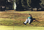 United States President George H.W. Bush lies on the ground as he lines-up a putt during a round of golf in Kennebunkport, Maine on August 7, 1991.<br /> Mandatory Credit: David Valdez / White House via CNP